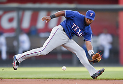 July 14, 2017 - Kansas City, MO, USA - Texas Rangers shortstop Elvis Andrus runs down a ground out on Kansas City Royals' Whit Merrifield in the first inning during Friday's baseball game July 14, 2017 at Kauffman Stadium in Kansas City, Mo. (Credit Image: © John Sleezer/TNS via ZUMA Wire)