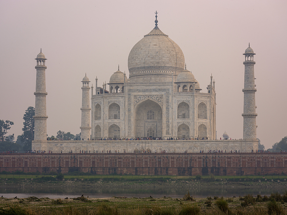 AGRA, INDIA - CIRCA NOVEMBER 2018: View of the Taj Mahal from Mehtab Bagh. The Taj Mahal is an ivory-white marble mausoleum on the south bank of the Yamuna river in the Indian city of Agra. The Taj Mahal is one the most recognizable buildings in India and a World Heritage Site.. Agra is a city and very popular tourist destination on the banks of the Yamuna river in the Indian state of Uttar Pradesh.