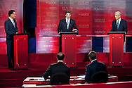 Mitt Romney, Rick Perry, and Ron Paul..Eight republican candidates for US President face off at a debate held at the Ronald Reagan Library. The debate was sponsored by NBC News and POLITICO, and was moderated by Brian Williams, anchor of NBC Nightly News.