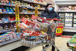 © Licensed to London News Pictures. 21/12/2020. London, UK. Shoppers in Sainsbury's supermarket in north London before 8am, buying festive groceries, just four days before Christmas day amid a French ban on British hauliers. France closed its border to UK travellers from 11pm last night as London, the South East of England and many parts of the UK went into Tier 4 lockdown as a new variant of the COVID19 virus continues to spread. Photo credit: Dinendra Haria/LNP