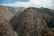 Mountain landscape view in the area near to Ota called the Gorges de Spelunca, Corsica, France. Corsica is an island in the Mediterranean and one of the 18 regions of France. It is located southeast of the French mainland and west of the Italian Peninsula.