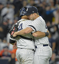 October 18, 2017 - Bronx, NY, USA - New York Yankees relief pitcher Tommy Kahnle, right, hugs catcher Gary Sanchez after the final out in a 5-0 win against the Houston Astros during Game 5 of the American League Championship Series at Yankee Stadium in New York on Wednesday, Oct. 18, 2017. The Yankees' win gives them a 3-2 series lead. (Credit Image: © Howard Simmons/TNS via ZUMA Wire)