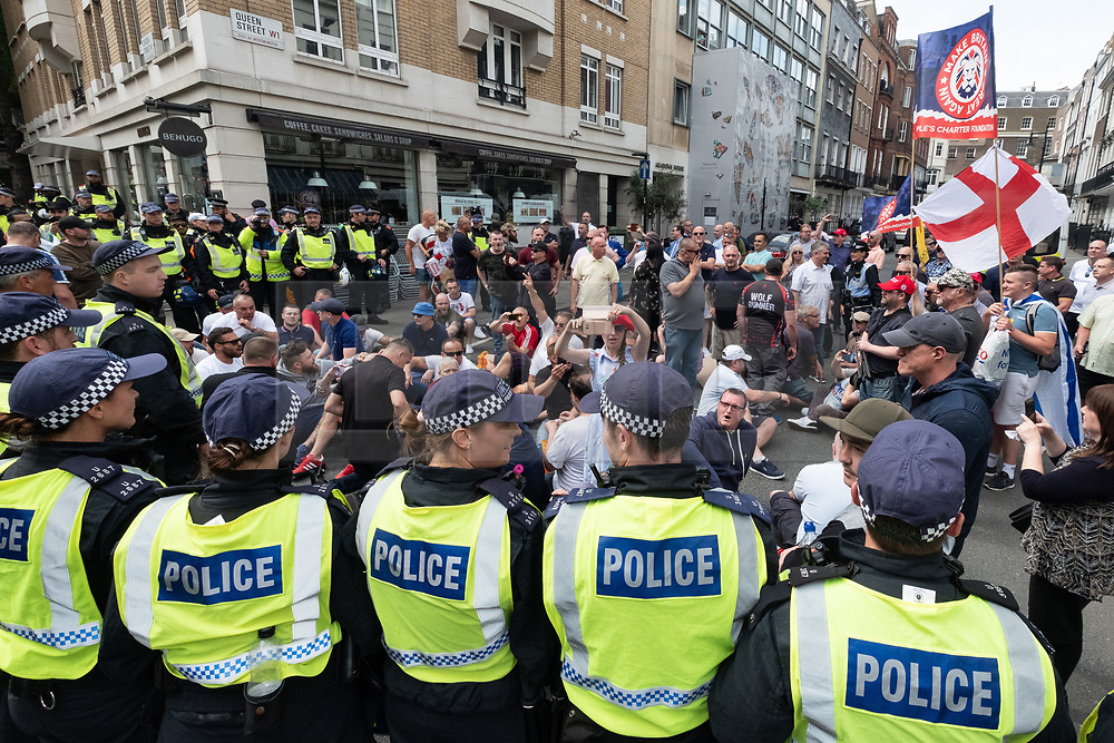 © Licensed to London News Pictures. 10/06/2018. London, UK. Counter protesters sit in the street at the annual Al Quds day march in support of the Palestinian cause, in central London. Photo credit: Ray Tang/LNP