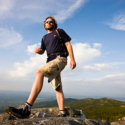 A man hikes near the summit of Mount Monadnock in Monadnock State Park in Jaffrey, New Hampshire.