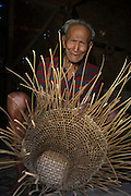 Ao Naga making basket<br /> Ao Naga Headhunting Tribe<br /> Mokokchung district<br /> Nagaland,  ne India