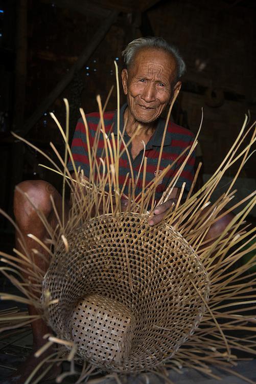 Ao Naga making basket<br /> Ao Naga Headhunting Tribe<br /> Mokokchung district<br /> Nagaland,  ne India