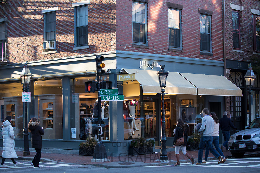 Street scene of young people strolling in the shopping district of Charles Street and Chestnut Street in Beacon Hill historic district, Boston, USA