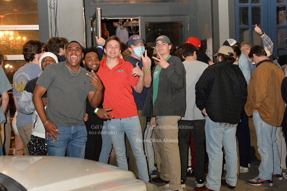 """3/4/21 Oxford, Mississippi Students of The University of Mississippi, aka, Ole Miss, party and enjoy a night out on the second night after Governor Tate Reeves lifted the state wide mask mandate. Pictured is a group of students waiting to get into a bar called Rafters in downtown Oxford.The Library bar and Rafters in downtown Oxford were packed with students shoulder to shoulder drinking and partying. Dr Fauci has stated that Mississippi and Texas residents should continue to abide by public health measures, including wearing masks and social distancing, even as Republican Governors have lifted all Covid-19 restrictions in Texas and Mississippi. In a move President Biden has called """"Neanderthal thinking"""" , which Governor Tate Reeves of Mississippi took offense too. Governor Tate Reeves dropped the mask mandate March 3rd, 2021. Mississippians had mixed feelings regarding the mask mandate to begin with and the Governors  lack of leadership regarding Covid-19 and the pandemic. ©Suzi Altman Photographer DailyMail.com"""
