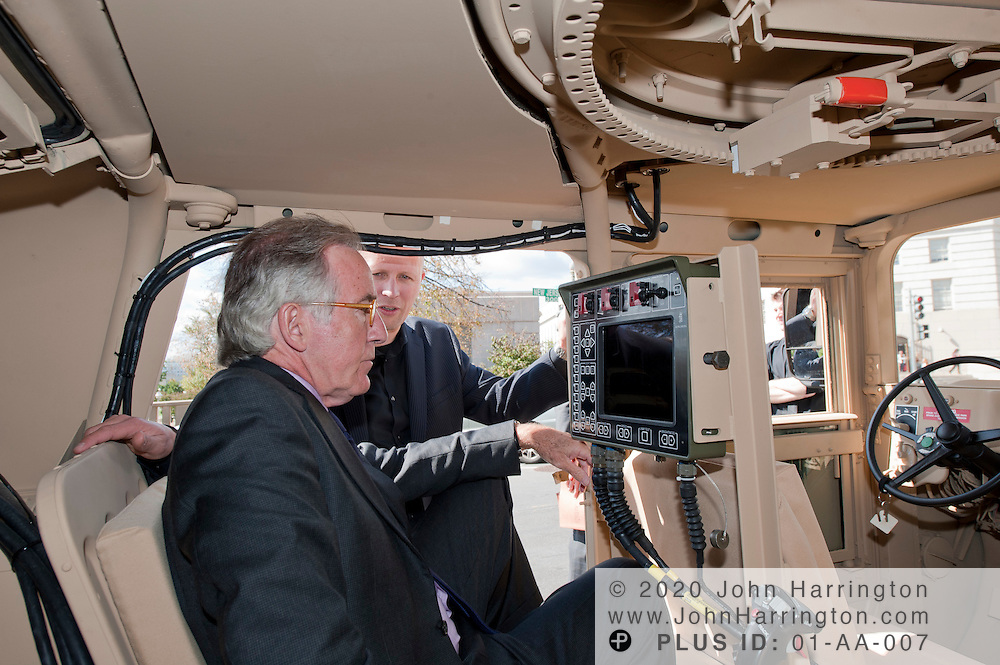 """In this photograph provided by Kongsberg Protech Systems Rep. Richard Neal (D-MA) looks at military hardware during a demonstartion on Capitol Hill on Tuesday, October 4th, 2011. Kongsberg Protech Systems was on Capitol Hill demonstrating their """"Protector CROWS"""", remote weapons station to members of Congress, senators, and their staff."""