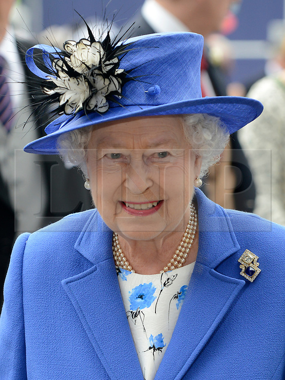 © Licensed to London News Pictures. 02/06/2012. London, UK. HRH Queen Elizabeth II arrives at The Investic Derby Festival today 2nd June 2012. The Royal Jubilee celebrations. Great Britain is celebrating the 60th  anniversary of the countries Monarch HRH Queen Elizabeth II accession to the throne this weekend Photo credit : Stephen Simpson/LNP