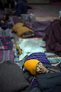 An old man sleeping in the Fatepuri night shelter for the homeless in Old Delhi, India.