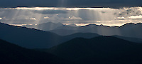 crepuscular rays formed by light through the clouds above the Gifford Pinchot National Forest in the Cascade Mountain Range in Washington state, USA panorama