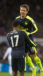 SWANSEA, WALES - Saturday, January 14, 2017: Arsenal's Alex Iwobi celebrates his second goal with Nacho Montreal against Swansea City during the FA Premier League match at the Liberty Stadium. (Pic by Gwenno Davies/Propaganda)