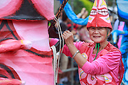 Elderly performer guidea a float at the Dream Parade, Taipei