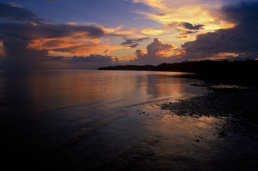 Tide pools reflect a storm during sunset at Cape Sable, a remote wilderness beach in Everglades National Park, Florida.