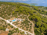 Aerial panoramic view of Brac island, villa and pool in Sumartin, Croatia.