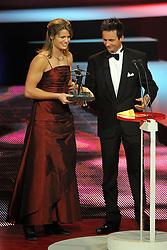 12-12-2011 ALGEMEEN: NOS NOC NSF SPORTGALA: DEN HAAG<br /> Dafne Schippers is verkozen tot talent van het jaar en ontvangt uit handen van Johnny Hoogerland de Jaap Eden trofee tijdens het Sportgala 2011 in Den Haag<br /> ©2011-WWW.FOTOHOOGENDOORN.NL