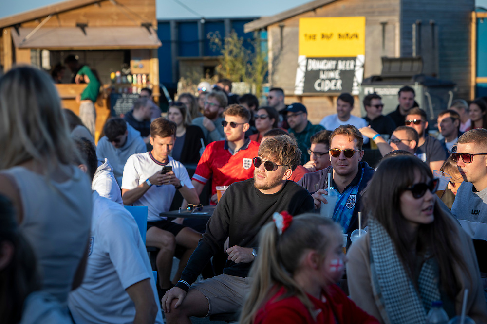 England fans watching the Euro 2020 semi final match between England and Denmark on the 7th of July 2021 at the outdoor screen at Folkestone Harbour Arm, in Folkestone, United Kingdom. (photo by Andy Aitchison / Folkestone Harbour Arm)