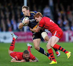 Chris Pennell of Worcester Warriors is tackled by Jack Tovey of Bristol Rugby - Photo mandatory by-line: Patrick Khachfe/JMP - Mobile: 07966 386802 27/05/2015 - SPORT - RUGBY UNION - Worcester - Sixways Stadium - Worcester Warriors v Bristol Rugby - Greene King IPA Championship Play-off Final (Second leg)