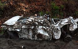 January 10, 2018 - Burbank, California, U.S. - Burbank Police Dept., Sgt. MARSHA LAUFER, checks one of two automobiles destroyed during a recent mudslide along Country Club Drive. (Credit Image: © Ed Crisostomo/Los Angeles Daily News via ZUMA Wire)