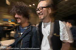 "Custom Builders Kaichiroh ""Kross"" Kurosu of Cherry's Company with Yuichi Yoshizawa of Custom Works Zon at pre-party for the Mooneyes Yokohama Hot Rod & Custom Show. Yokohama, Japan. December 5, 2015.  Photography ©2015 Michael Lichter."