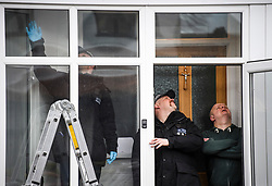 © Licensed to London News Pictures. 04/04/2018. London, UK. A specialist police team search for a bullet at a property hit by gunshot on Chalgrove Road in Tottenham, where 17 year old Tanesha Melbourne was shot dead. A recent spree of killings in the capital has taken the murder toll for the year so far to 48. Photo credit: Ben Cawthra/LNP