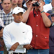 The Open Championship 2005. Old Course St Andrews. Tiger Woods and a spectator having a very close look. <br />  Picture Robert Perry Scotland on Sunday. Sat 16th July 2005.