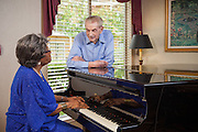 Active Seniors Singing and Playing Piano