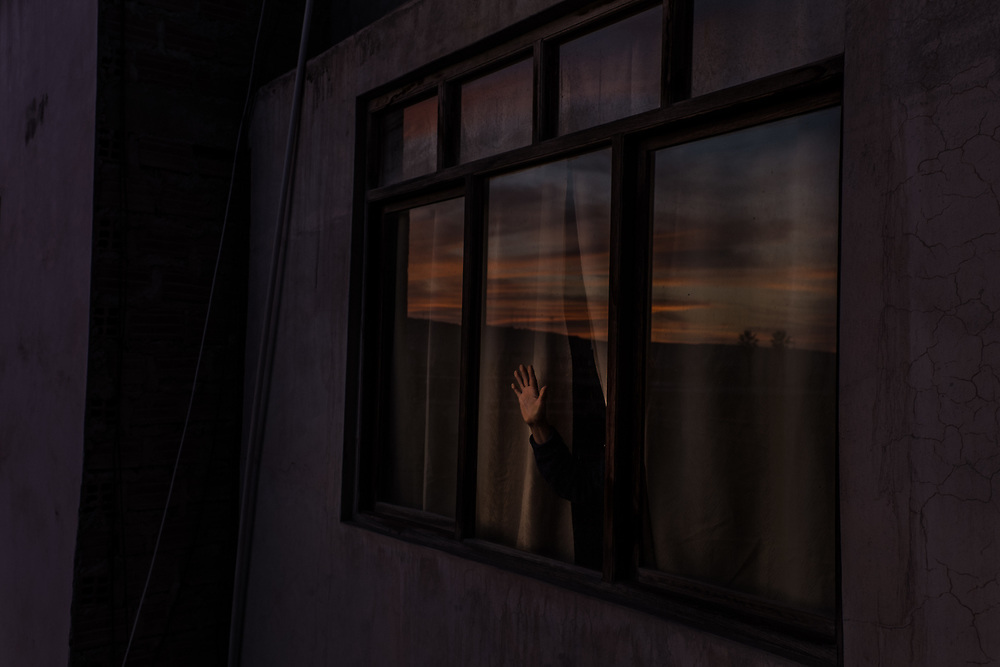 Mom leans against the window to watch the sunset. She has lived in this house for almost 15 years and I have lived far from her for 15 years. My mom is passionate about photography and she always sends me photos of the sunsets that she sees from that window. This quarantine brought me closer to her again and I was finally able to see them together.