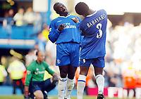 Photograph: Scott Heavey.<br />Chelsea v Tottenham Hotspur from Stamford Bridge. 13/09/2003.<br />Jimmy Floyd Hasselbaink celebrates with Celestine Babayaro