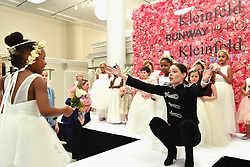 """Coco Rocha releases a photo on Twitter with the following caption: """"""""SO SWEET! @cocorocha greets a little model today at the #RunwayHeroes event at @KleinfeldBridal, a fashion show exclusively featuring young girls who are fighting cancer or are in remission, all modeling flower girl dresses. ❤️"""""""". Photo Credit: Twitter *** No USA Distribution *** For Editorial Use Only *** Not to be Published in Books or Photo Books ***  Please note: Fees charged by the agency are for the agency's services only, and do not, nor are they intended to, convey to the user any ownership of Copyright or License in the material. The agency does not claim any ownership including but not limited to Copyright or License in the attached material. By publishing this material you expressly agree to indemnify and to hold the agency and its directors, shareholders and employees harmless from any loss, claims, damages, demands, expenses (including legal fees), or any causes of action or allegation against the agency arising out of or connected in any way with publication of the material."""