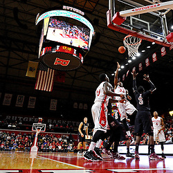 Wally Judge #33 of the Rutgers Scarlet Knights lays up a shot over Anthony Lee #3 of the Temple Owls during Rutgers men's basketball vs Temple Owls in American Athletic Conference play on Jan. 1, 2014 at Rutgers Louis Brown Athletic Center in Piscataway, New Jersey.