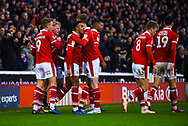 Jacob Brown of Barnsley (33) scores a goal and celebrates with team mates to make the score 1-0 during the EFL Sky Bet League 1 match between Barnsley and Bradford City at Oakwell, Barnsley, England on 12 January 2019.