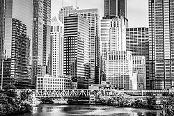 Black and white picture of Chicago buildings at Lake Street Bridge along the Chicago River. Photo is high resolution and was taken in 2012.
