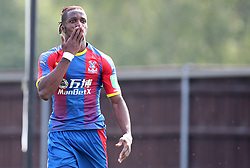 Crystal Palace's Wilfired Zaha celebrates scoring his side's second goal of the game during a pre season friendly match at The Kassam Stadium, Oxford.