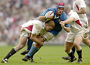 Twickenham, Surrey, 9th March2003, Six nations International Rugby,  RFU Stadium, England, [Mandatory Credit; Peter Spurrier/Intersport Images]<br /> Photo Peter Spurrier<br /> 09/03/2003<br /> RBS Six Nations Rugby England v Italy<br /> Christian Bezzi is tackle by Joe Worsley left and Gramham Rowntree