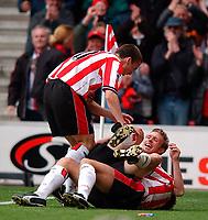 Photo. Richard Lane<br />Southampton v Leeds United. Barclaycard Premiership 19/04/2003.<br />Brett Ormerod celebrates his goal with James Beattie and David Prutton