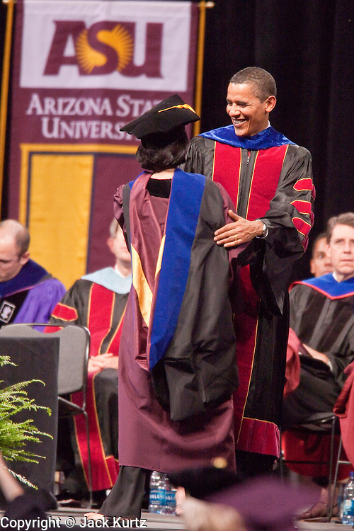 """13 MAY 2009 -- TEMPE, AZ:  President Barack Obama congratulates doctoral grads after they were """"hooded."""" President Barack Obama addressed the Arizona State University class of 2009 during the commencement program in Sun Devil Stadium in Tempe Wednesday evening. PHOTO BY JACK KURTZ"""