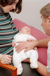 Baby having cranio sacral therapy,