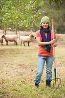 Portrait of young woman working on farm.