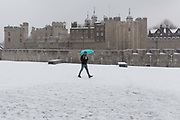 A man with an umbrella walks near the Tower of London during snow fall in London, England on March 2nd, 2018 as freezing weather, dubbed the Beast from the East combined with Storm Emma have brought snow and freezing weather to the UK.