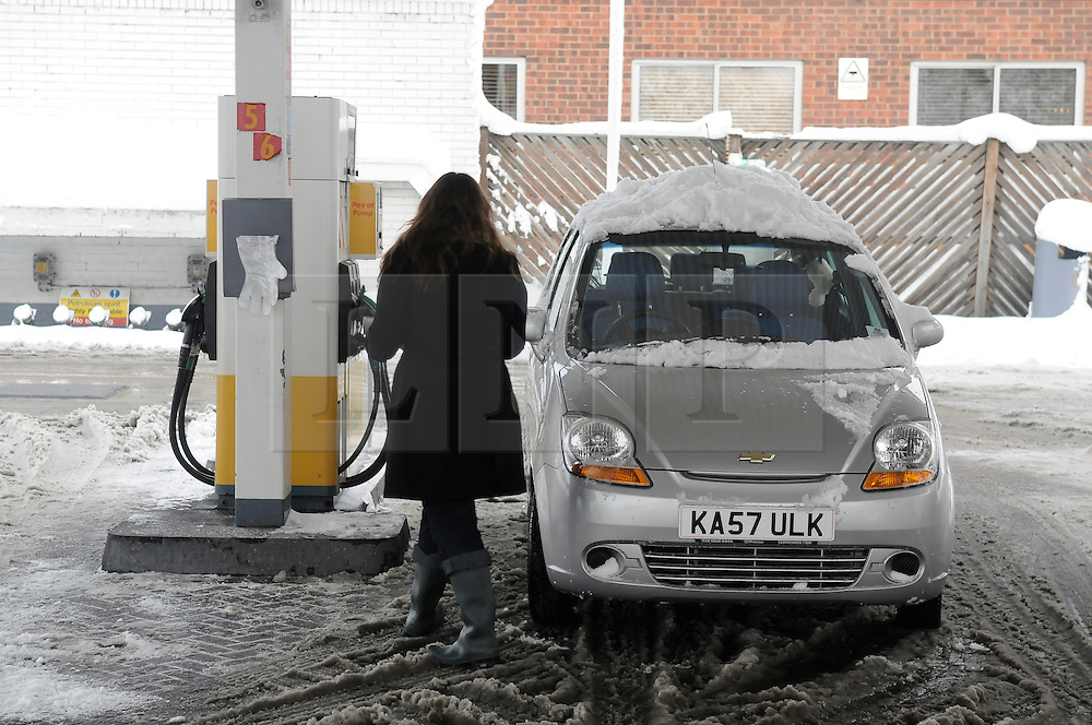 © under license to London News Pictures.3.12.2010 A woman buys petrol at a petrol station in Pettswood, Kent,  today (Fri)  Picture credit should read Grant Falvey/London News Pictures