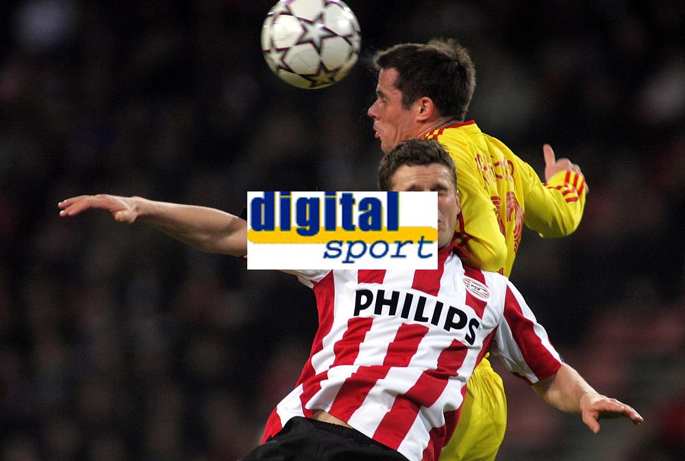 Photo: Paul Thomas.<br /> PSV Eindhoven v Liverpool. UEFA Champions League, Quarter Final, 1st Leg. 03/04/2007.<br /> <br /> Jamie Carragher (R) of Liverpool battles Jason Culina.