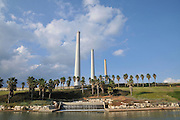 Israel, Hadera, The Hadera River and park the coal operated power plant's flues in the background
