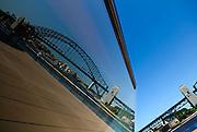 Sydney Harbour Bridge reflected in Sydney Opera House window. Sydney, Australia
