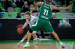 Jaka Blazic of Union Olimpija vs Kelly McCarty of Unics Kazan during basketball match between KK Union Olimpija and Unics Kazan (RUS) of 10th Round in Group D of Regular season of Euroleague 2011/2012 on December 21, 2011, in Arena Stozice, Ljubljana, Slovenia. Unics Kazan defeated Union Olimpija 76-63. (Photo by Vid Ponikvar / Sportida)