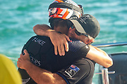Emirates Team New Zealand Flight controller Blair Tuke gives his father Andy Tuke a hug after winning the America's Cup against Luna Rossa Prada Pirelli Team 7 - 3.  Wednesday the 17th of March 2021. Copyright photo: Chris Cameron