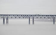 Newburgh, New York -  Fog covers the Hudson River as traffic crosses the Newburgh-Beacon bridge on a warm winter day, Jan. 2, 2010.