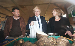"""© Licensed to London News Pictures. 23/02/2012. Wallington, Surrey. L-R: Seb Coe, Boris Johnson and Rosie Boycott, London Food Board. The Mayor of London, Boris Johnson and LOCOG Chairman Sebastian Coe today, 23 February 2012, showed off the benefits of urban food growing as they launched """"The Big Dig"""" volunteer gardening weekend (16-17 March). This is all in support of Capital Growth, a scheme to create 2,012 community food growing spaces by the end of 2012.  Photo credit: Bettina Strenske/LNP"""