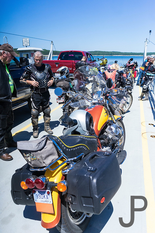 A nicely preserved Moto Guzzi cruiser is on the Peel Ferry with our crew.